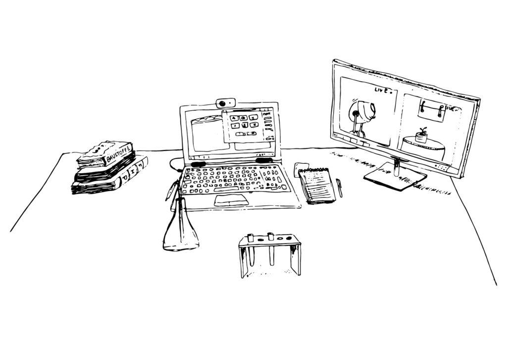 Schreibtisch mit Laptop, Kamera und Laborinstrumenten